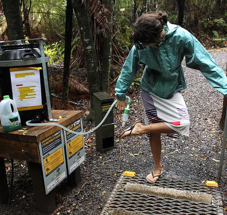 Clean all soil off your footwear and other gear, every time you enter or leave a forest/area with native trees, and at every cleaning station. Photo by Eli Duke is licensed under CC BY 2.0